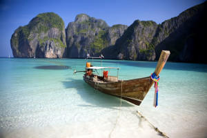 A long tail boat sits in Maya Bay, Koh Phi Phi Ley, Thailand. The place where the movie the Beach was filmed
