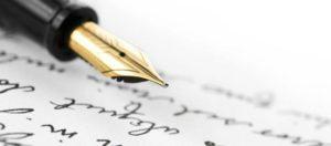 page d'écriture et stylo plume